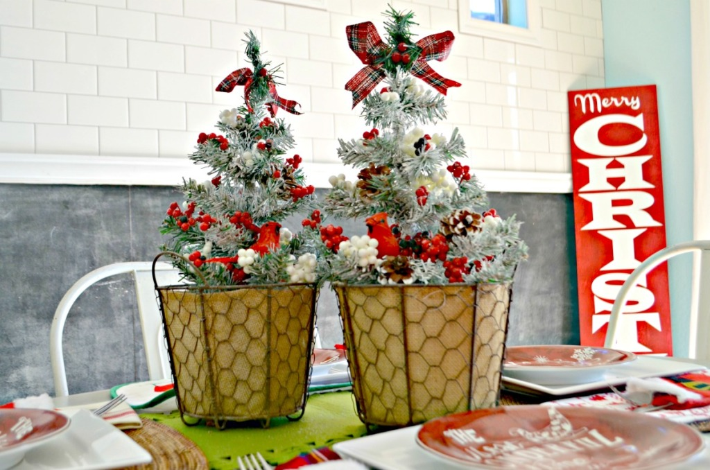 fluffing dollar tree christmas trees in planters