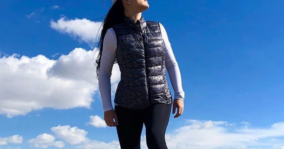 woman wearing puffer vest outside