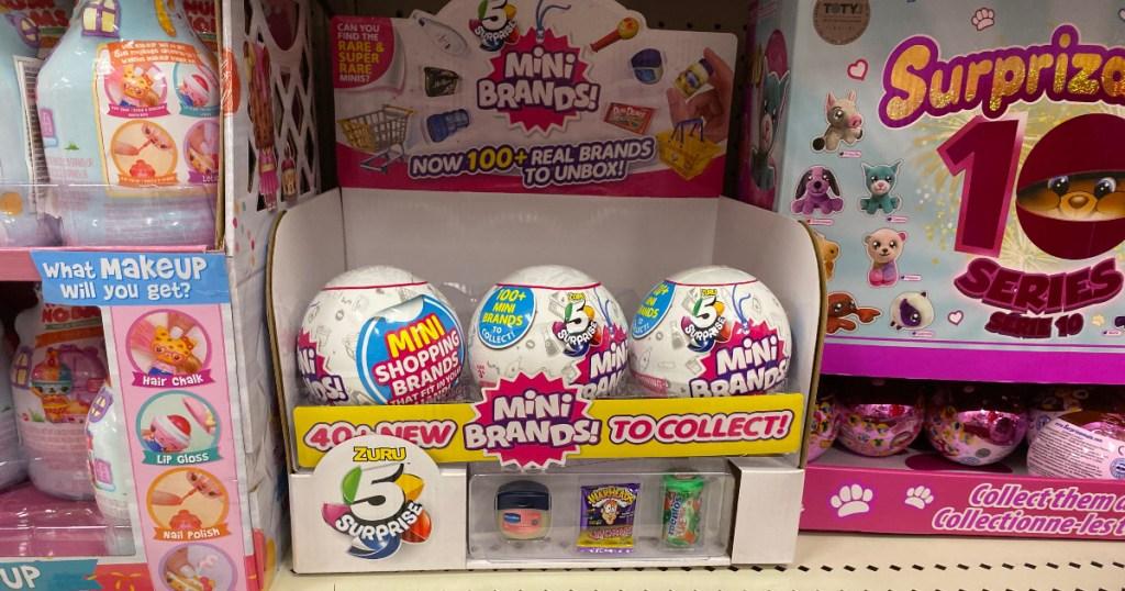 5 Surprise Mini Brands on shelf at Target