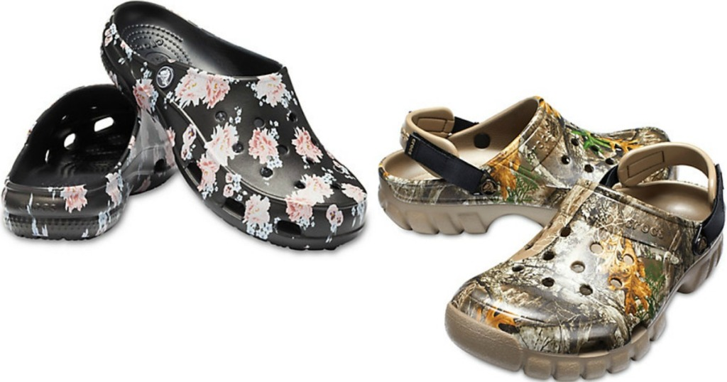 two pairs of Crocs one with flowers and the other in camo