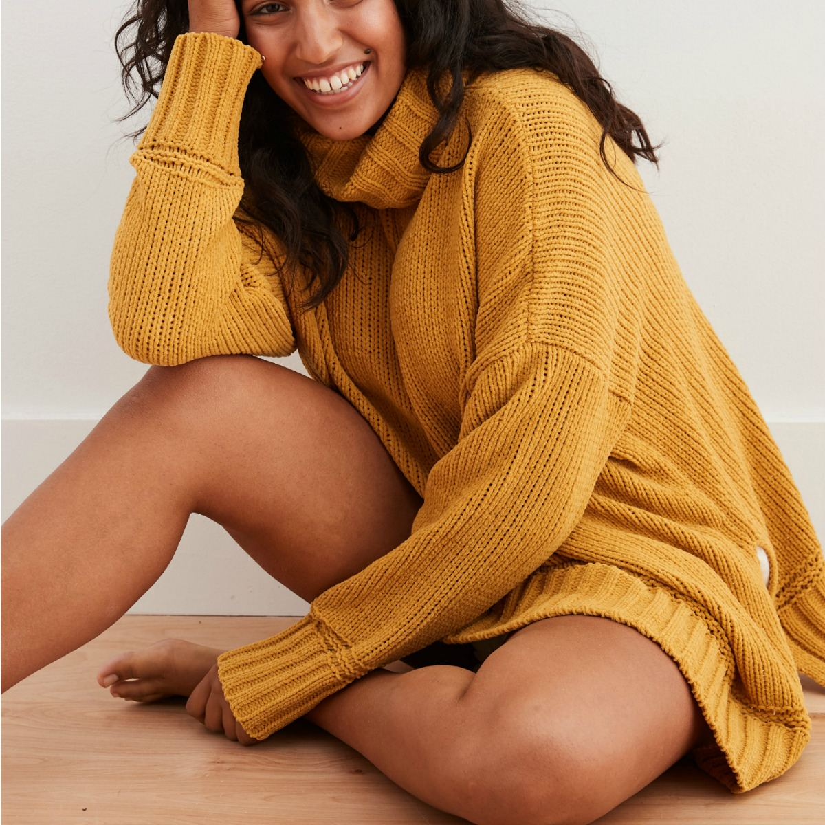 Woman wearing mustard colored chenille sweater