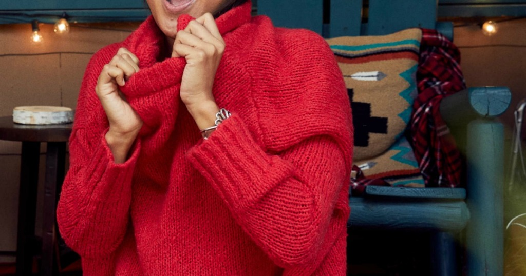 Woman wearing a red Aerie Over-sized chenille sweater