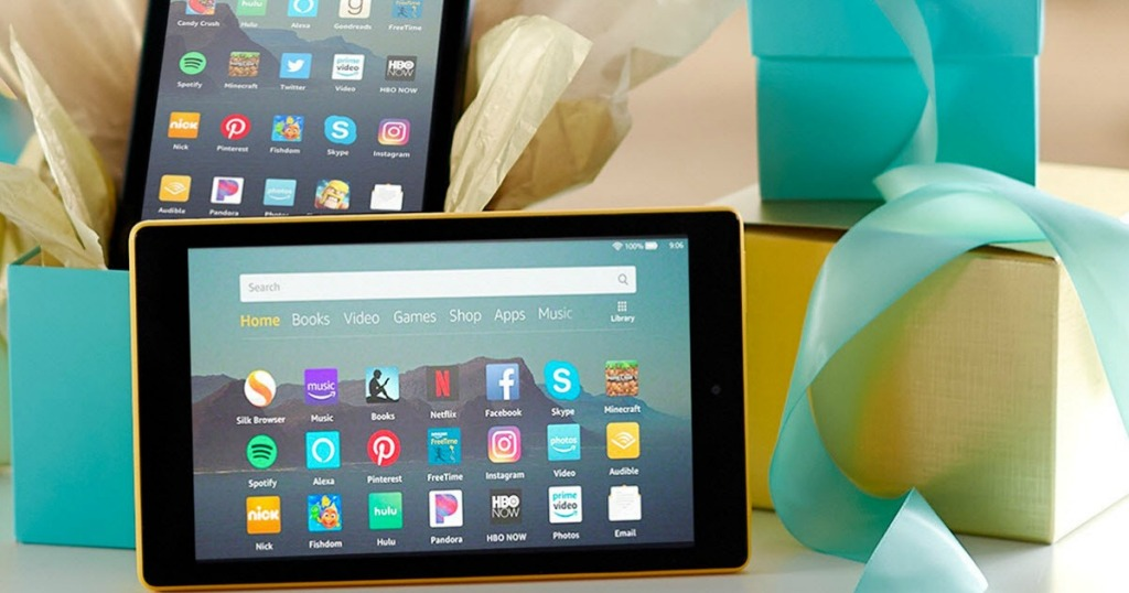 Amazon Fire Tablets next to gift boxes