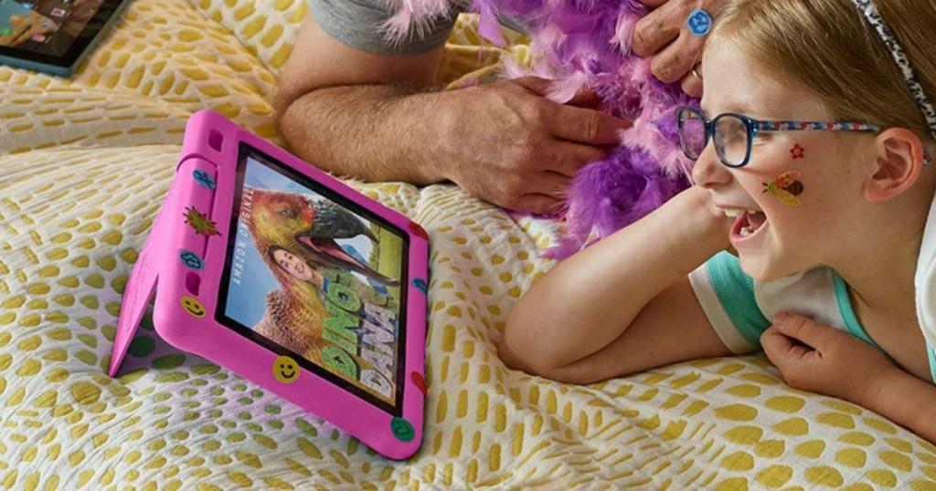 Girl watching Amazon show on pink kindle