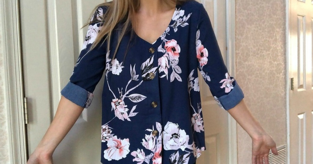 girl wearing a nice shirt in navy blue and floral