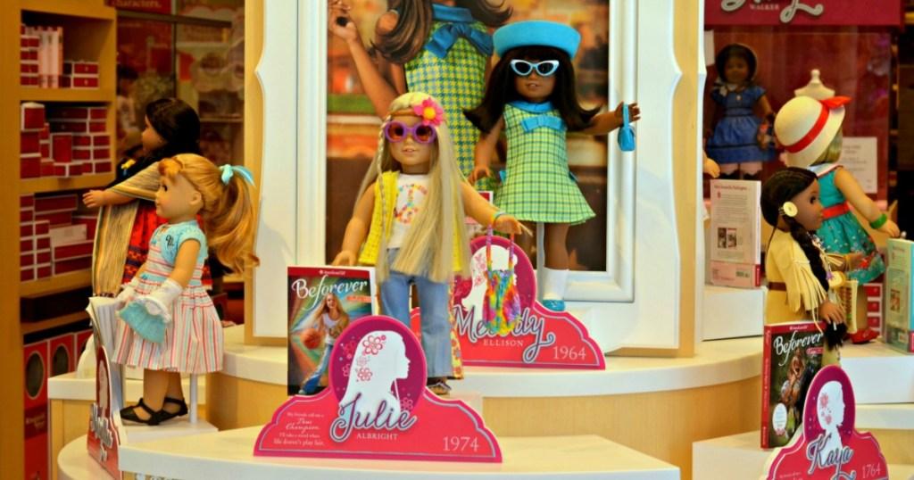 American Girl mini dolls with books on display
