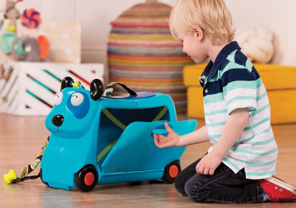 boy playing with B. toys Hound Dog Storage Ride-On