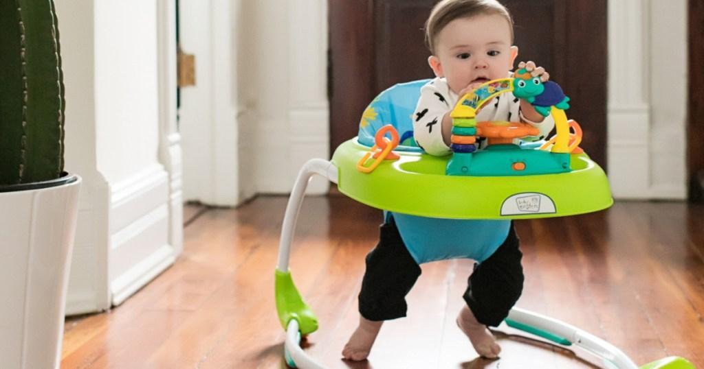 baby walking in Baby Einstein Sky Explorers Walker on hardwood floor