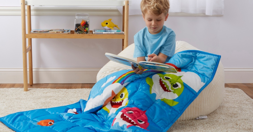 kid reading and using baby shark weighted blanket