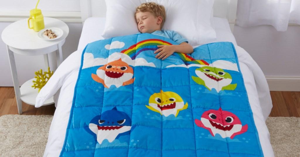 kid sleeping with baby shark weighted blanket