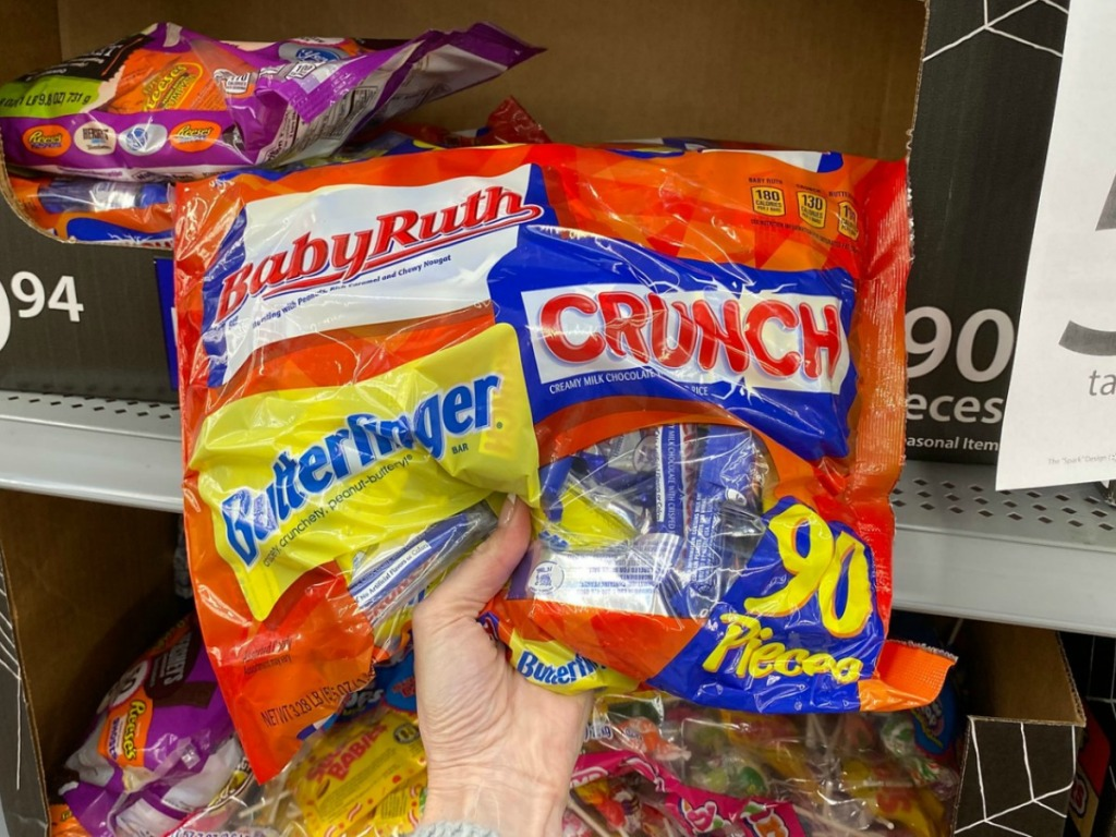 90-Piece bag of candy in hand from Walmart