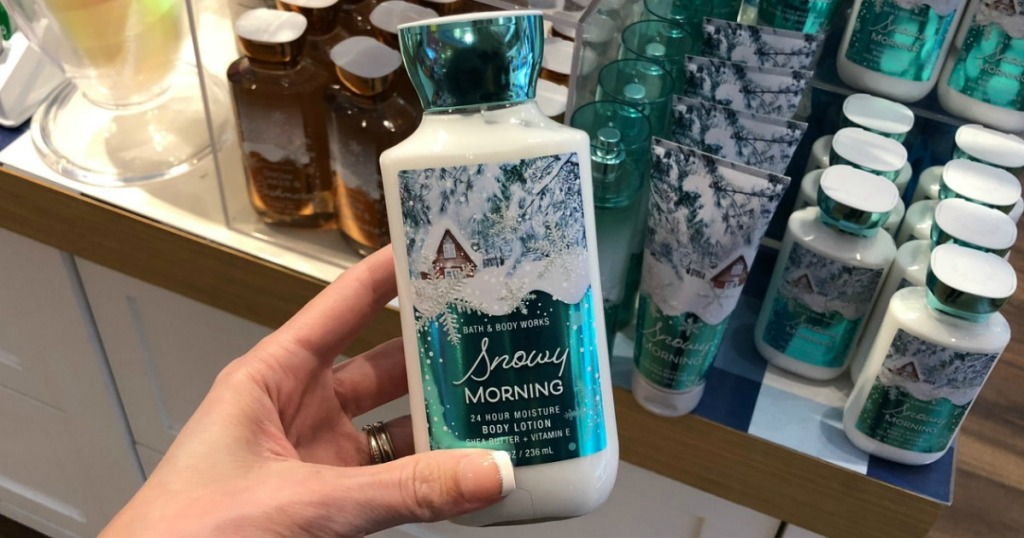 woman holding Bath & Body Works Body Lotion Winter