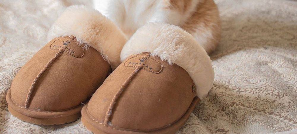 Bearpaw Fiona Slippers on bed