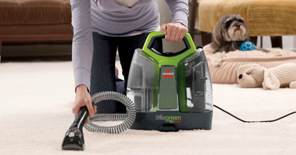 woman using Bissell Little Green ProHeat on carpets