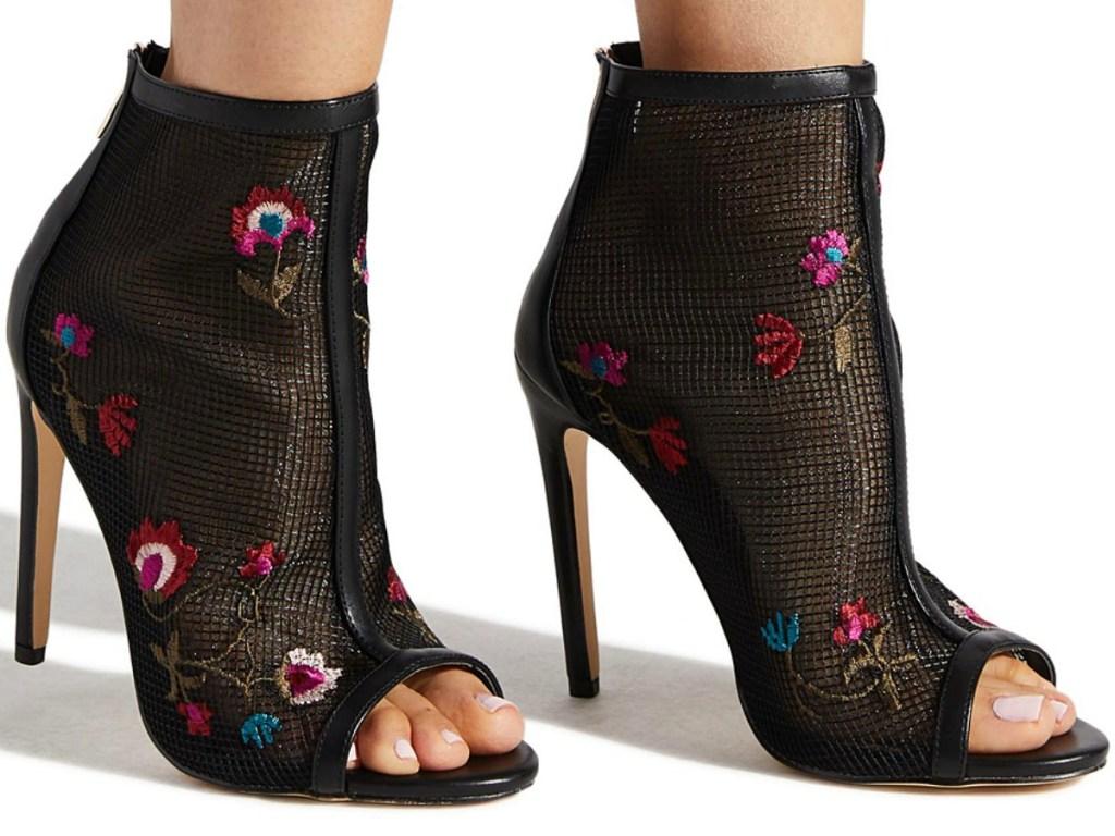 Woman wearing floral mesh booties