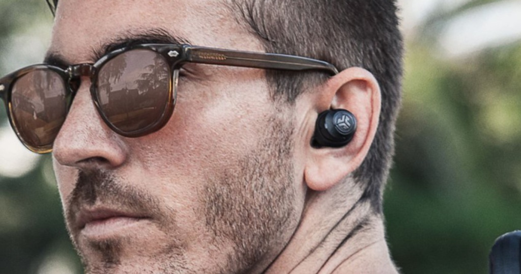Men wearing Jlab Jbud earbuds