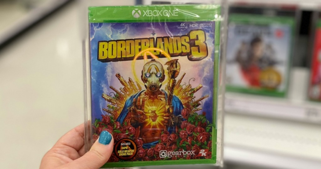 hand holding Borderlands 3 video game