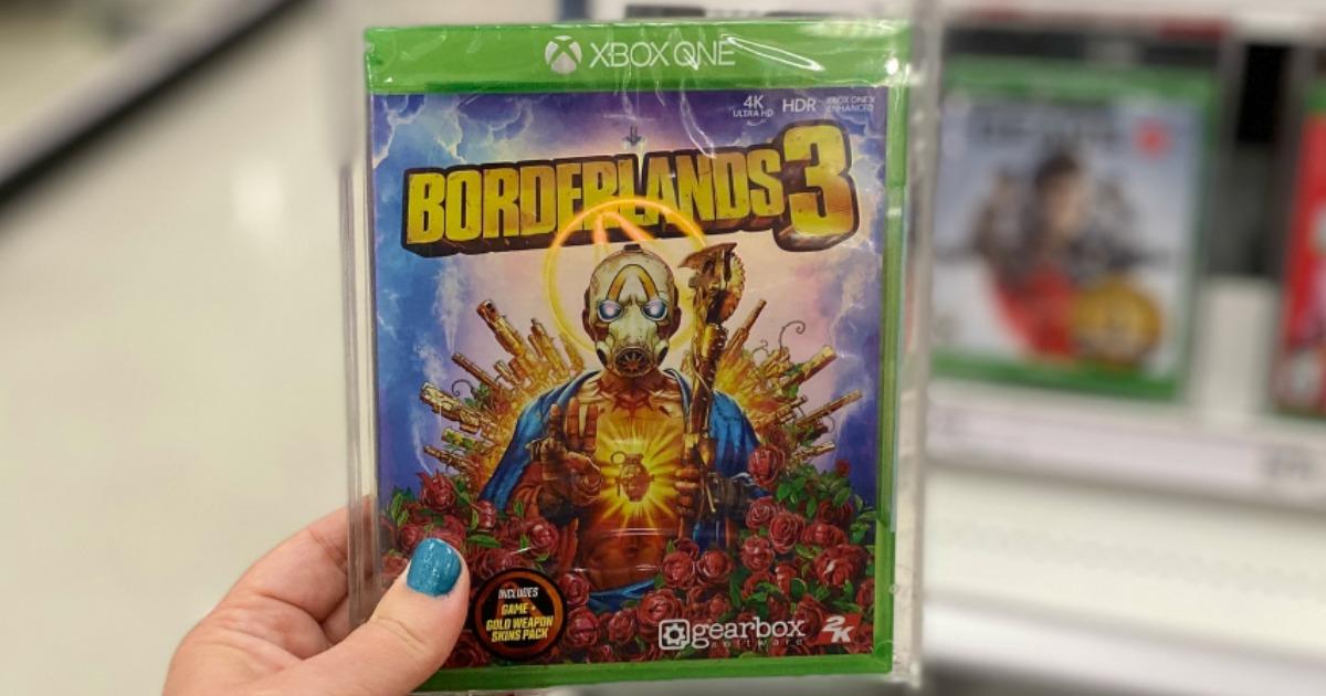 hand holding Borderlands 3 video game