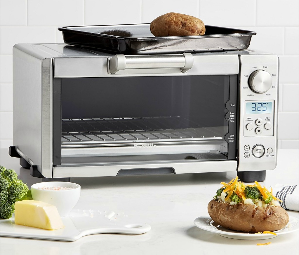 Breville Smart Oven surrounded by baked foods