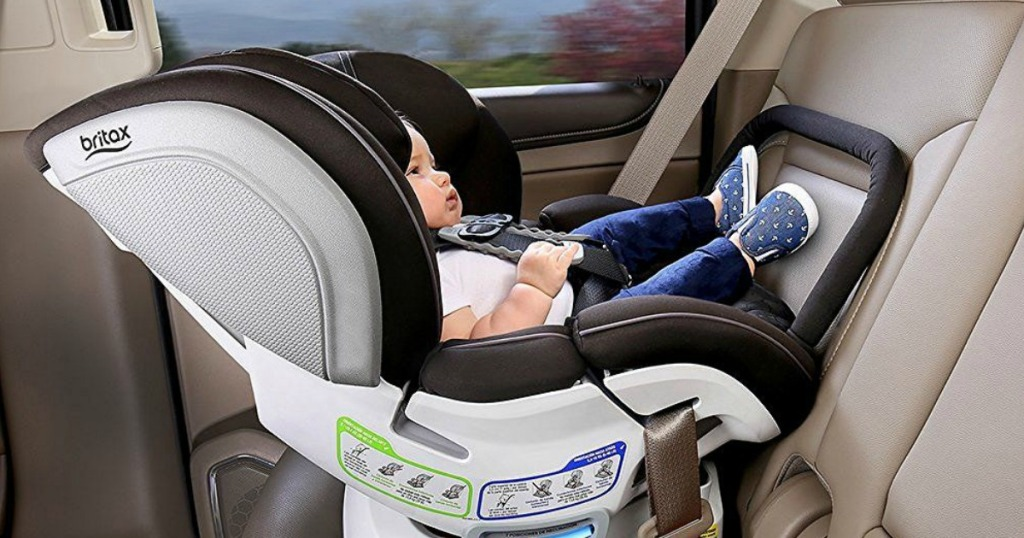 baby in car seat in back seat of vehicle