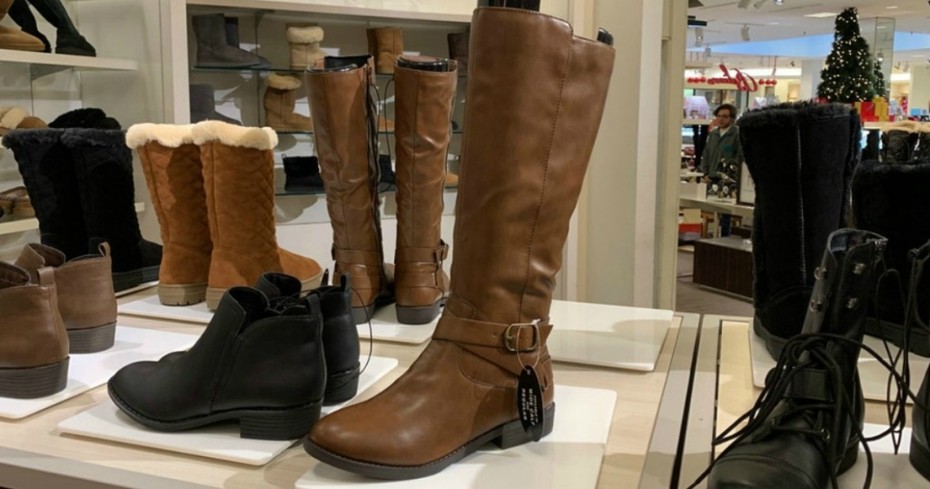 Style & Co Madixe Riding Boots on display in Macy's store