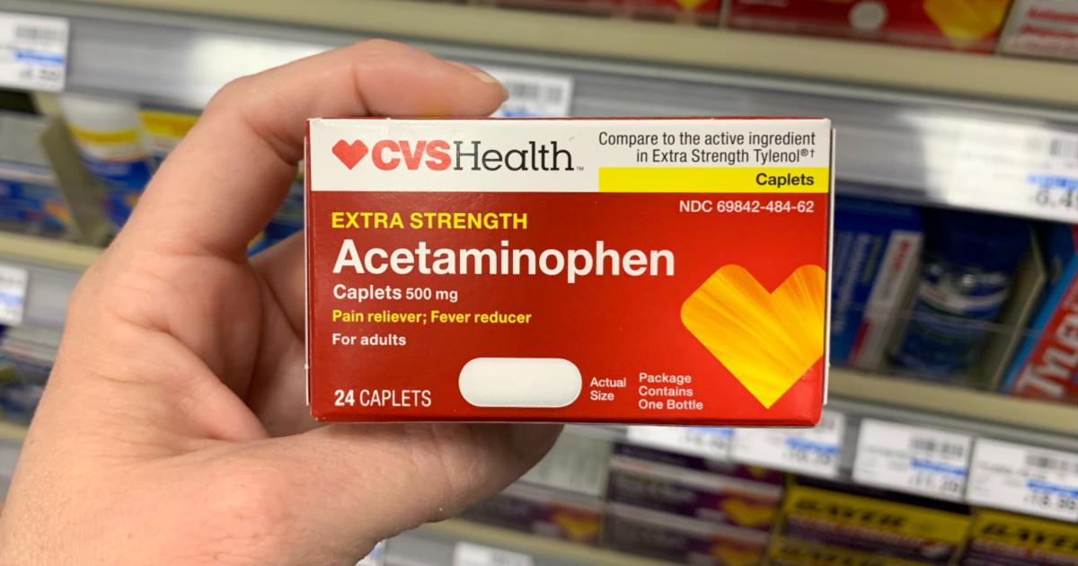 Hand holding CVS Acetaminophen