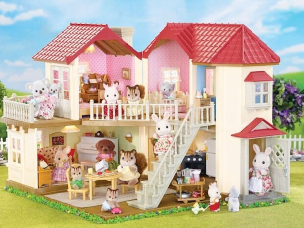 Calico Critters Luxury Townhome Gift Set with sky and grass in the background