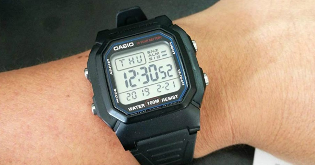 person wearing Casio Watch