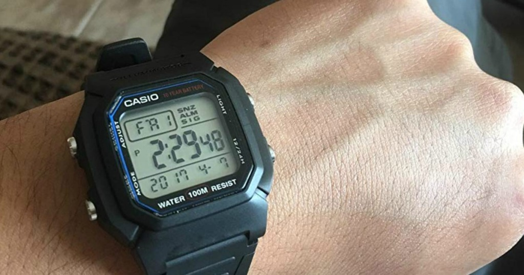 person wearing Casio watch on wrist