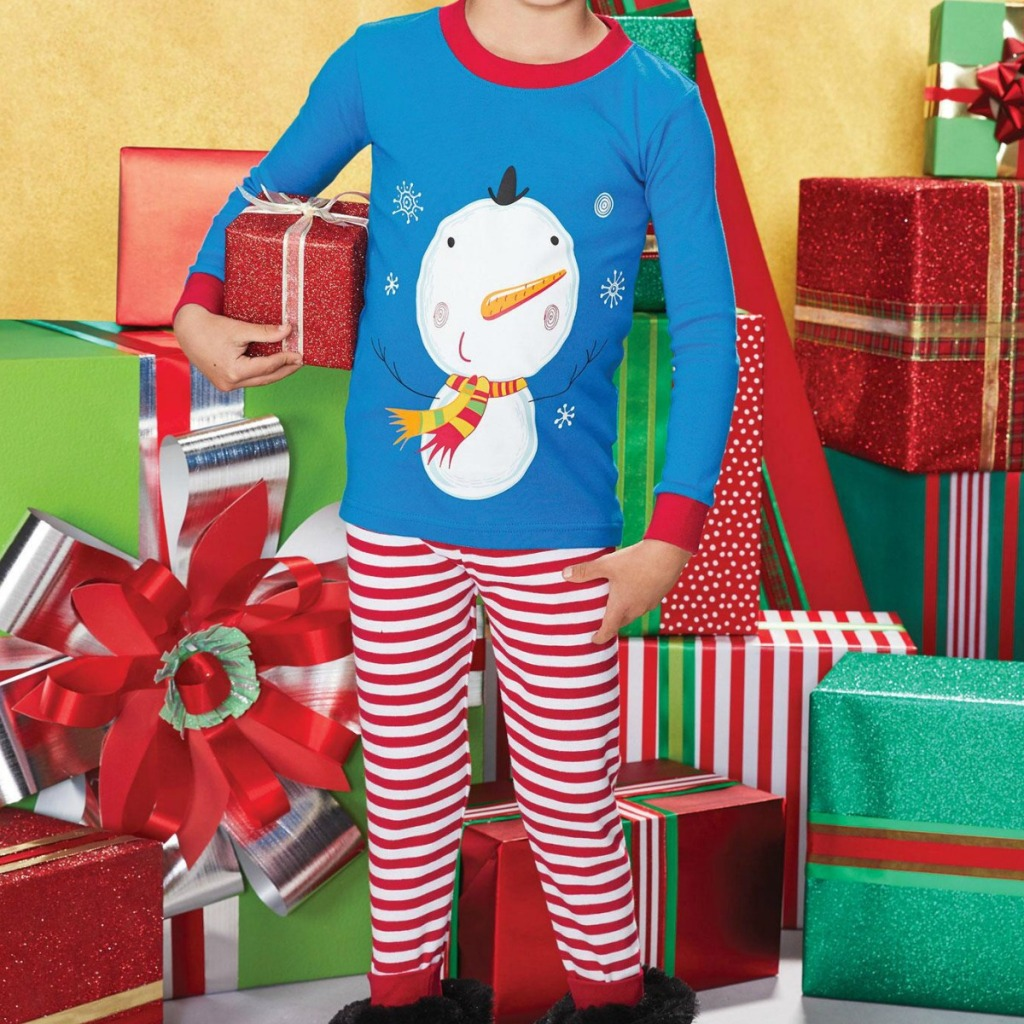 Boy wearing snowman themed pajamas