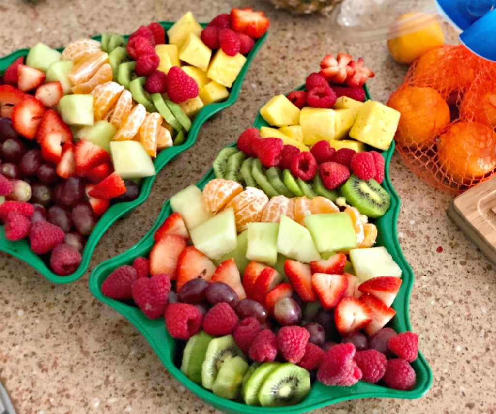 chopped fruit arranged in a Christmas tree pan