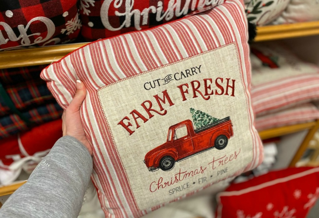 Christmas throw pillow in hand at Kohl's