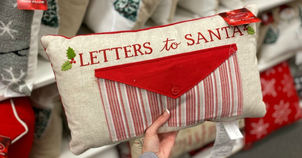 Linen Letters to Santa Pillow in hand at Kohl's