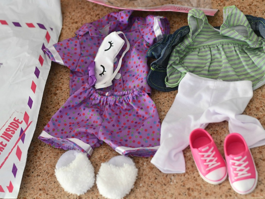 Club Eimmie Doll outfits near package on counter