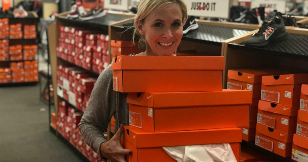 Woman Holding Nike Shoe Boxes