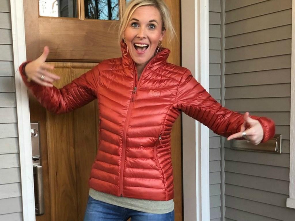 Woman wearing an REI Co-op Jacket in a doorway