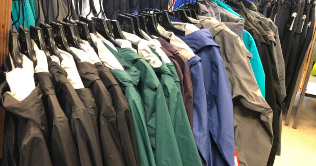 columbia jackets hanging on rack