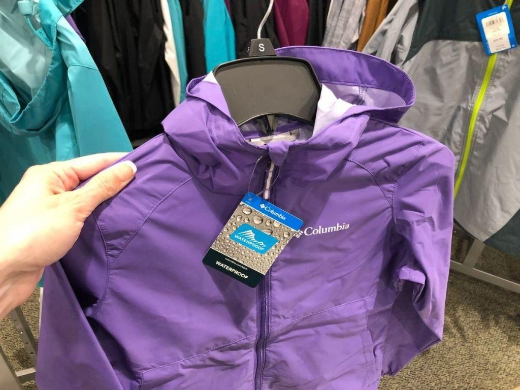 hand holding purple Columbia coat