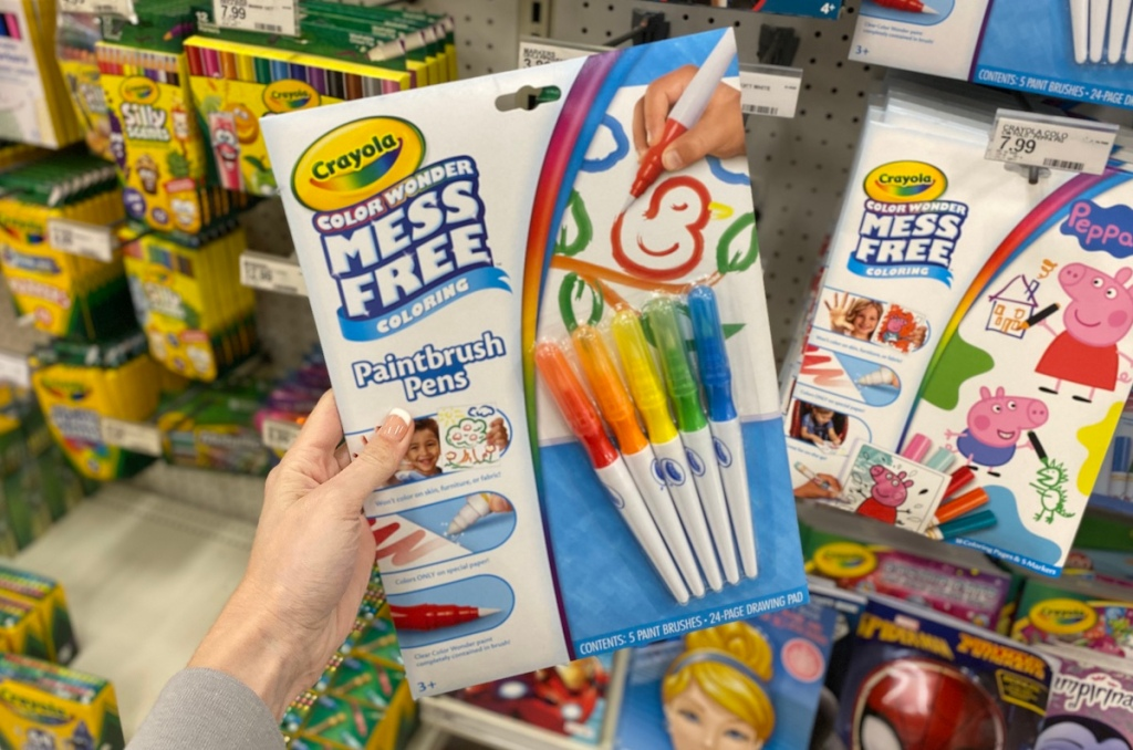 hand holding Crayola Paintbrush Pens set