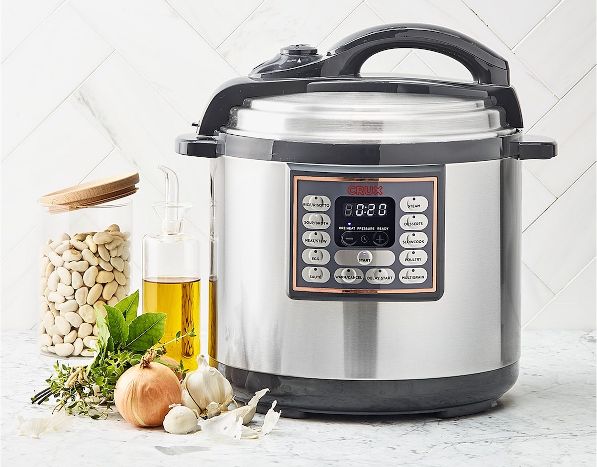stainless steel pressure cooker sitting on kitchen countertop