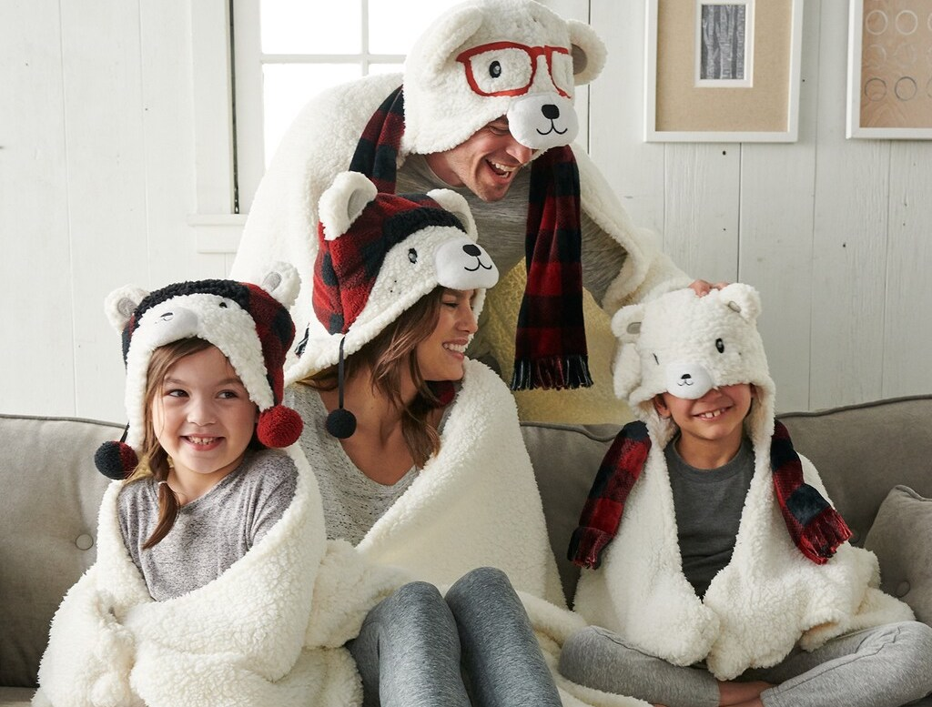 family wearing Cuddl Duds Hooded Blankets