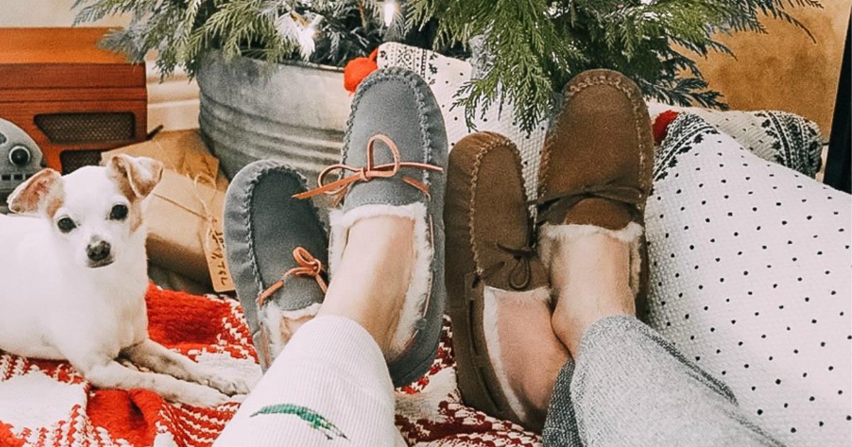 Man and Woman wearing Dearfoams sheepskin slippers near Christmas tree and pet dog