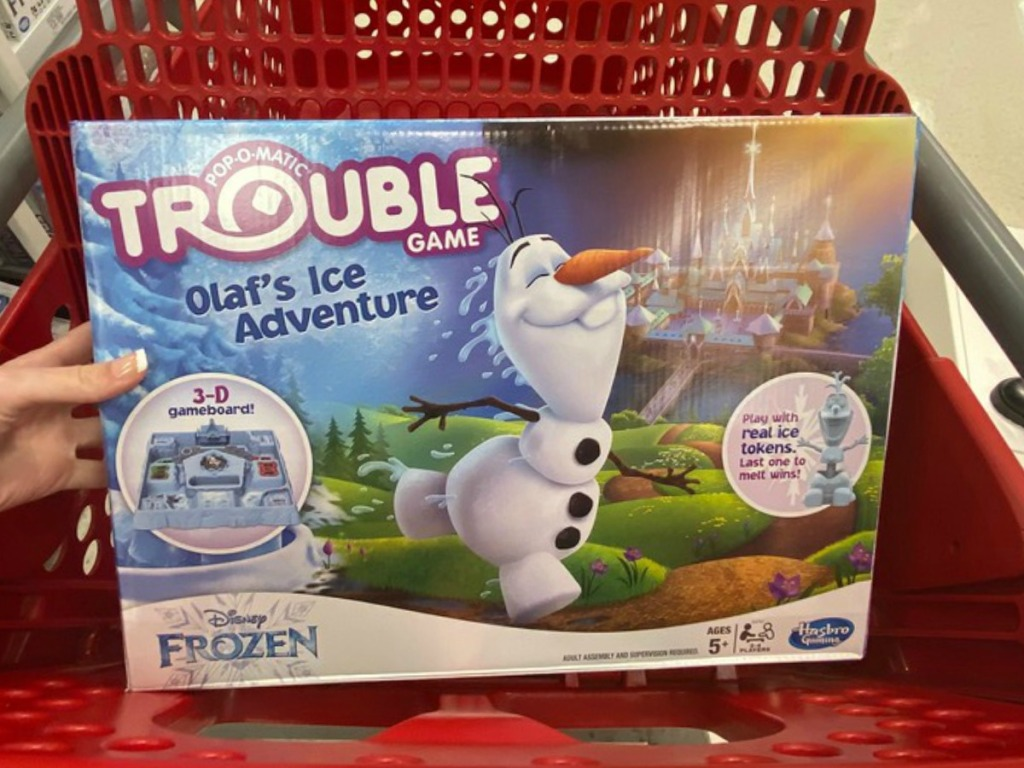 DisneyFrozen Olaf themed Trouble Board Game in seat of red shopping cart at Target