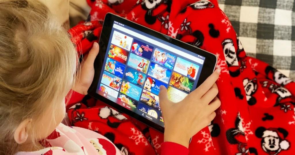 Girl watching Disney movies on iPad