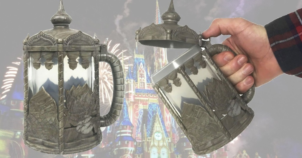 Disney Light Up Stein Mug in hand open in front of Disney Parks scene