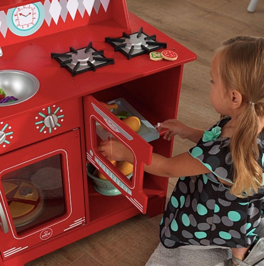 Girl playing with KidKraft Kitchenette