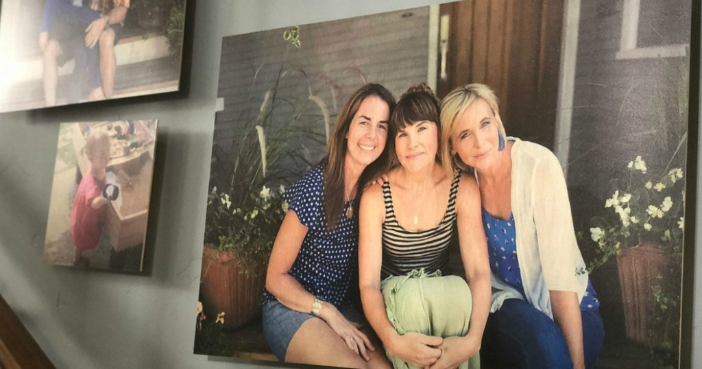 Canvas print of three sisters sitting on a doorstep