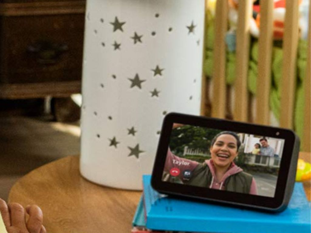 Echo Show 5 on table with star lamp