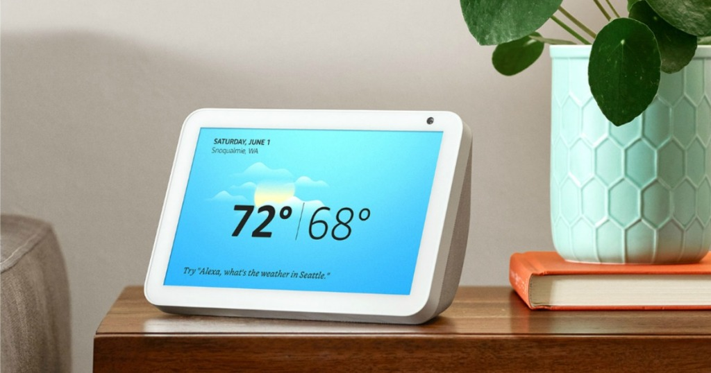 Echo Show 8 on desk next to orange book and plant
