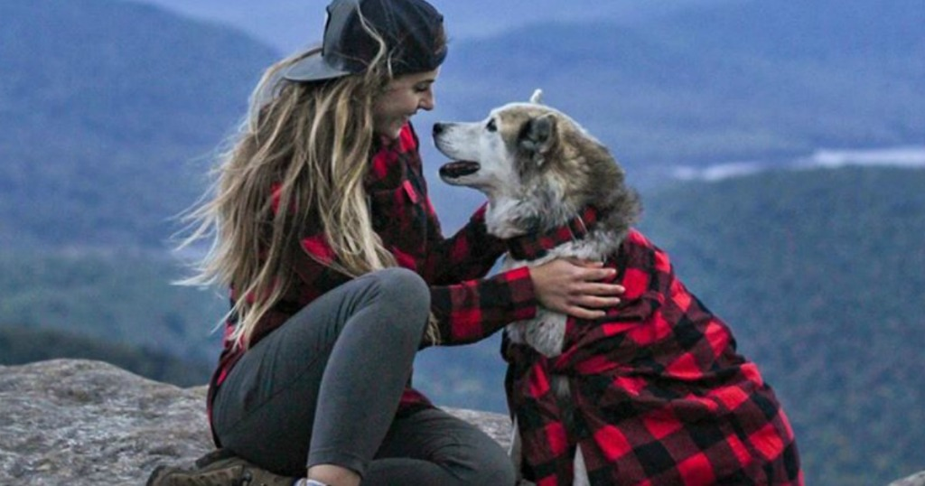 woman and dog wearing Eddie Bauer Flannel shirts